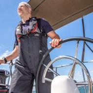 sailor at the helm of sunsail 41.0