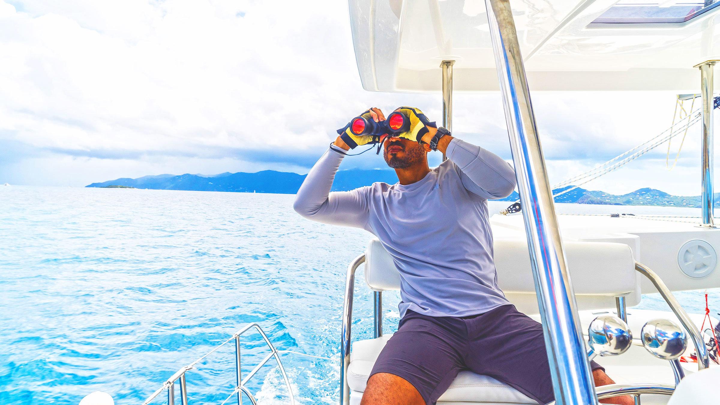 Sailor with binoculars on Sunsail catamaran