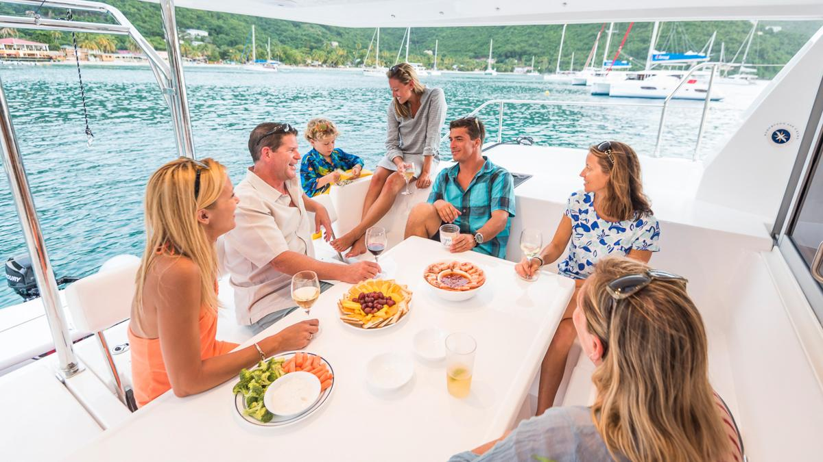 Guest on board a yacht enjoying a meal together