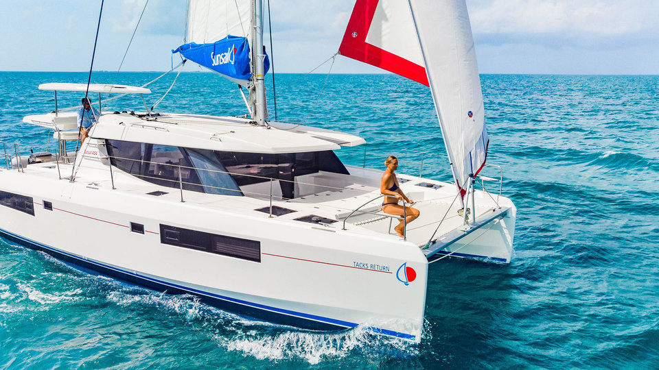 Guest sitting on Sunsail yacht while cruising