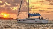 Crew sailing Sun Odysset 490 during sunset