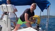 Skipper navigating yacht